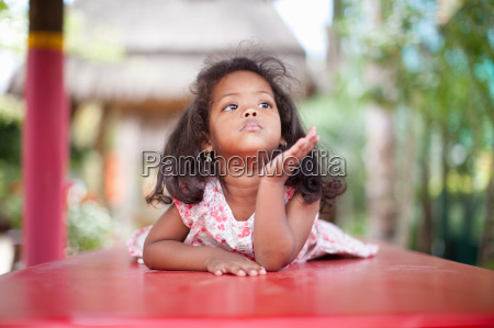 girl laying on picnic table
