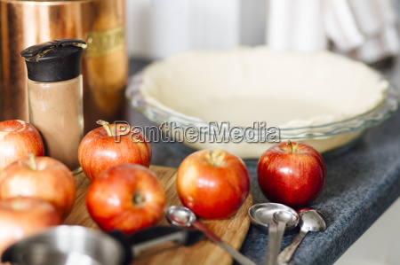 red apples on kitchen counter in