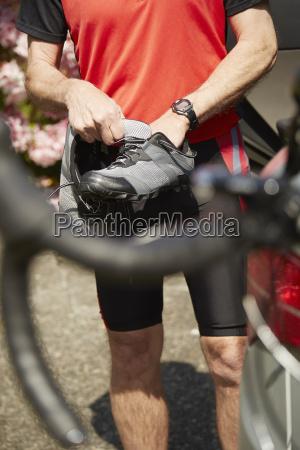 senior man preparing to use bicycle
