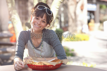 young woman sitting in outdoor cafe
