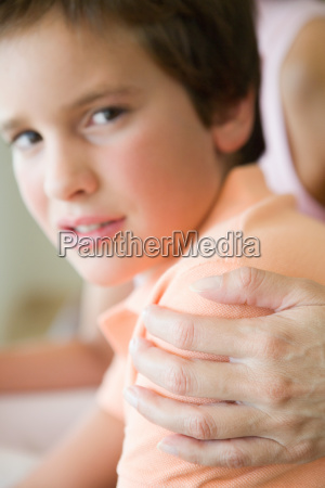 boy with mothers hand on his