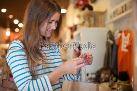 young woman in vintage shop with