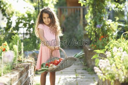 portrait of pretty girl holding basket