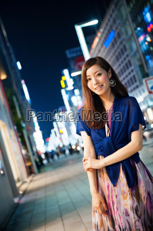 portrait of young woman on city