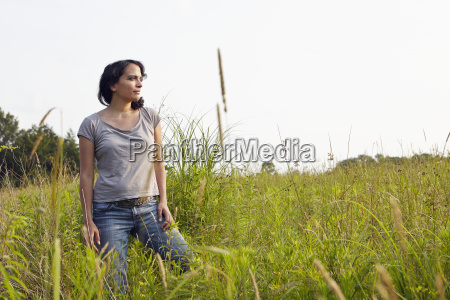woman looking out from field of
