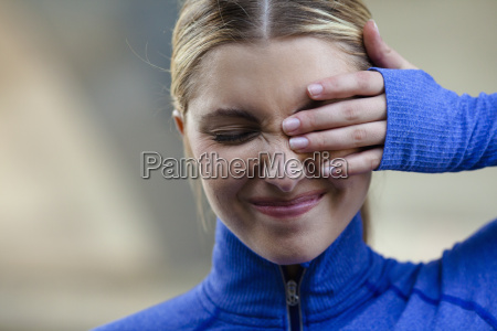 young woman squinting at discomfort in