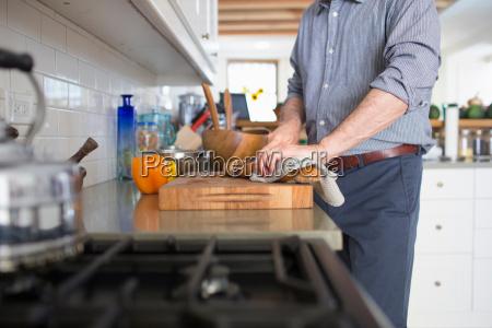 senior man preparing food at home