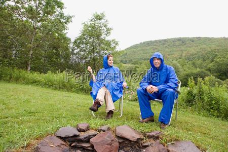 mature couple wearing raincoats