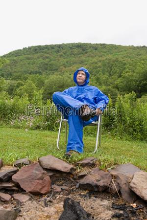 mature man wearing a blue raincoat