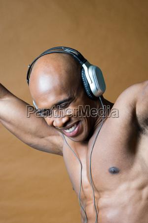 joyful man wearing headphones