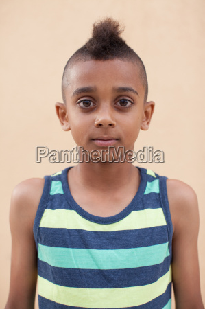 portrait of boy with mohawk hairstyle