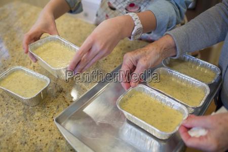 senior woman and granddaughter preparing baking