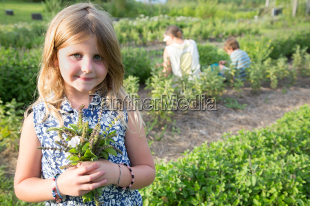 portrait of girl holding bunch of