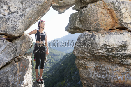 young female rock climber taking a