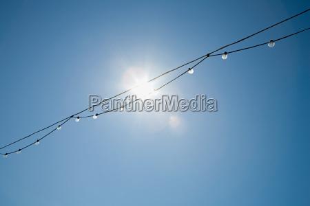 sunlight through a row of lightbulbs