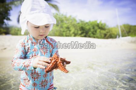 girl on beach wearing swimwear and