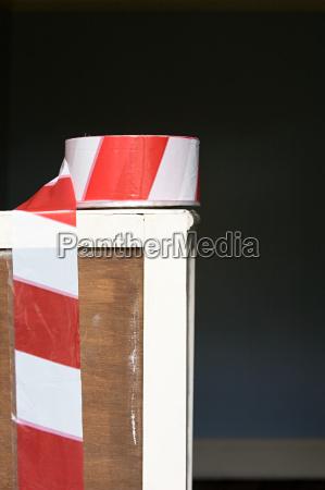 cordon tape on piece of furniture