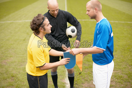 footballers exchanging shields