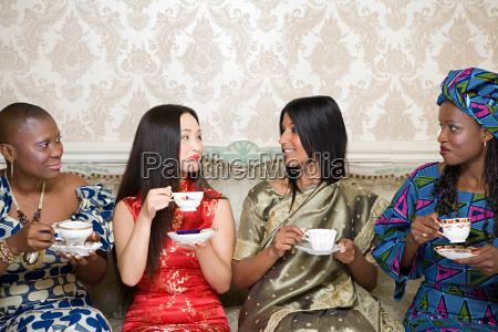four women in traditional clothing