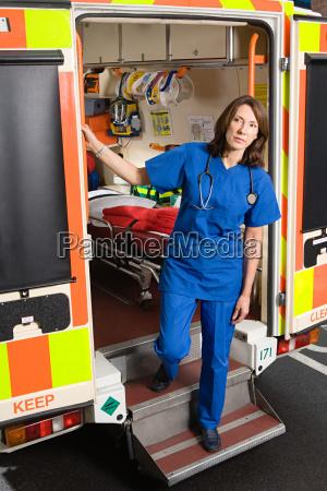 doctor on steps of ambulance