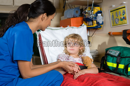 girl and nurse in ambulance