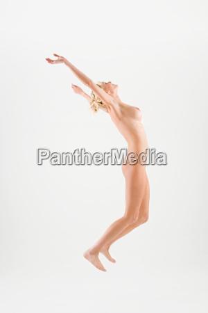 naked woman jumping