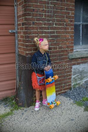 young girl wearing tutu and denim