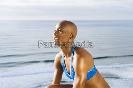 portrait of young woman beside sea