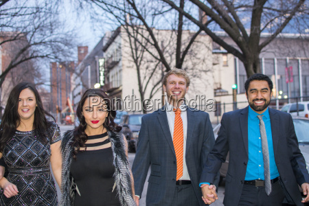 portrait of four smartly dressed young