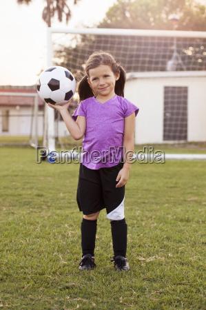 portrait of girl football player holding