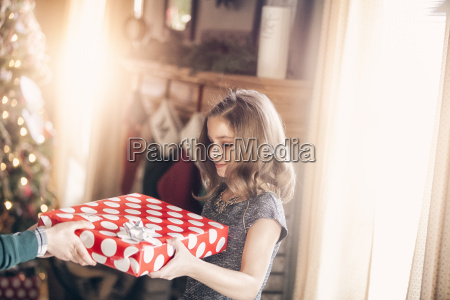 side view of girl receiving gift