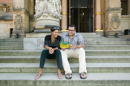 tourist couple on museum steps