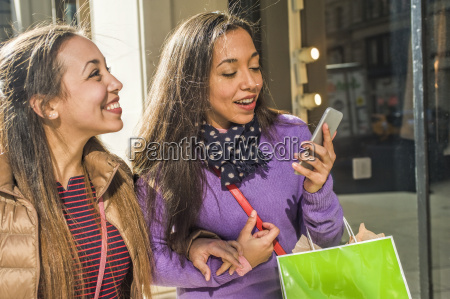 young female adult twins in city