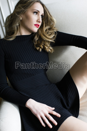 young woman sitting with legs apart