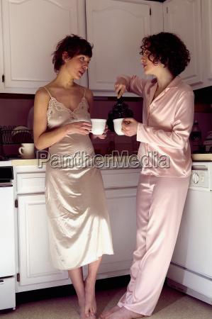 women drinking tea in kitchen