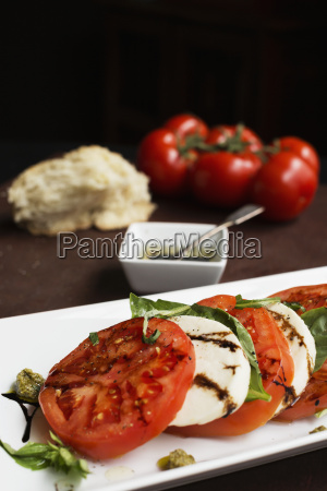 sliced vine tomatoes and mozzarella with