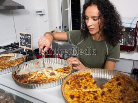 preparing food in delicatessen kitchen