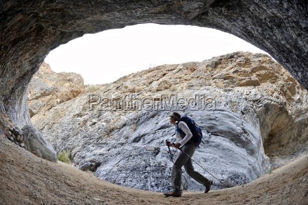 hiker exploring rock formations marble canyon