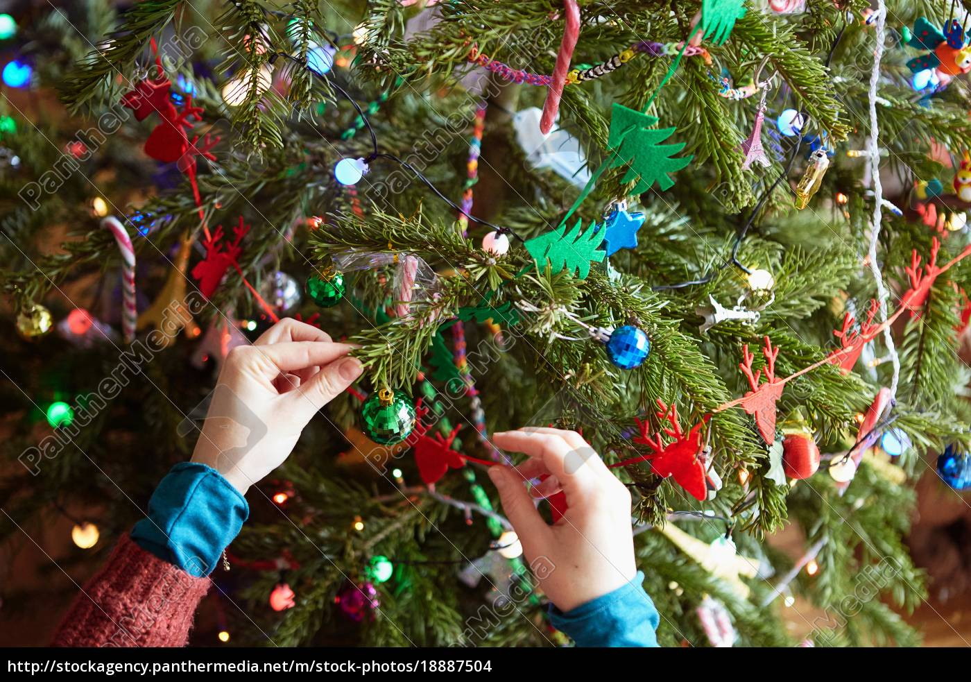 Womans Hands Preparing Xmas Decorations