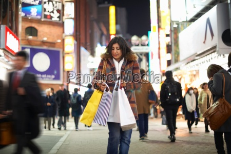 front view of mature woman carrying