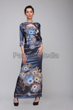 a woman in a long dress