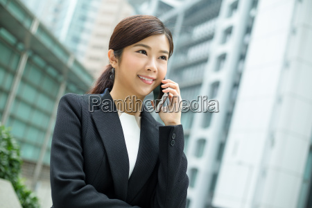 asian business woman chat on mobile