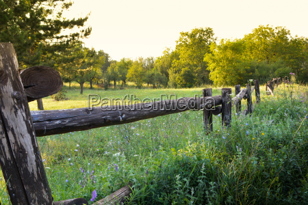 old rural wooden fence on beauty