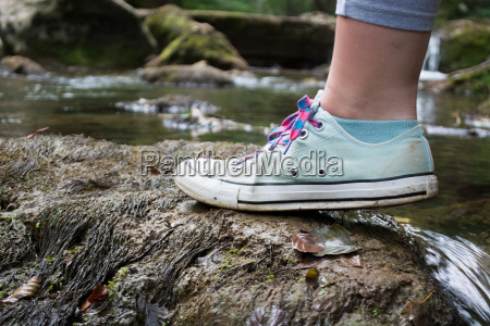 girls foot stepping on a mossy