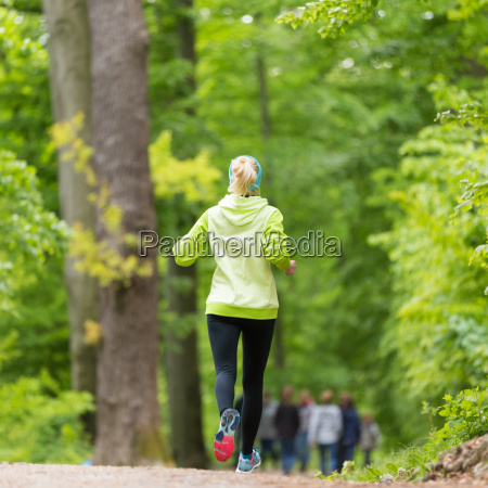 sporty young female runner in the