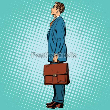 businessman standing sideways