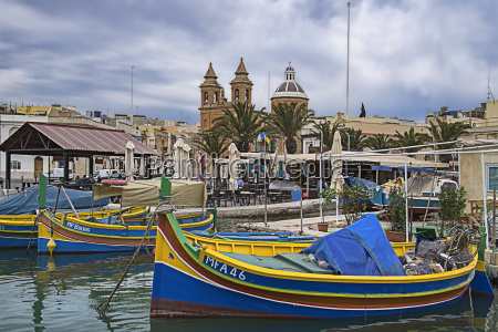 marsaxxlokk with fishing boats and cathedral