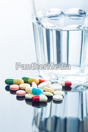 the different pills and glass of