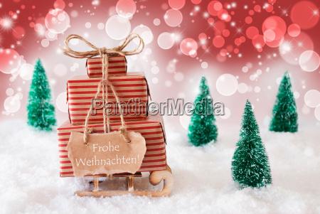sleigh on red background frohe weihnachten