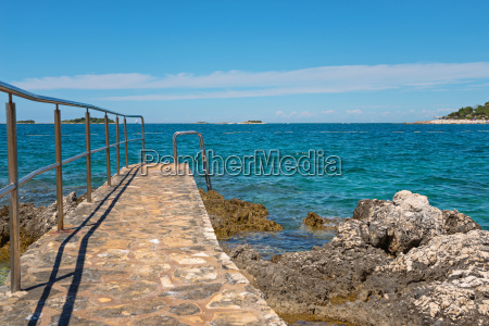pathway on the rocky beach in
